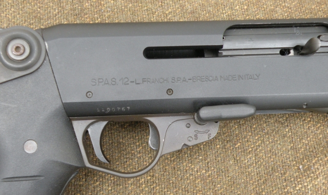 Later SPAS-12s were made with a push-button safety.